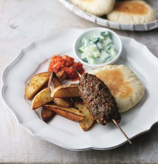 Kofta Kebabs served with Pitta Discs,Paprika Chips,Raita and Spicy Tomato Chutney