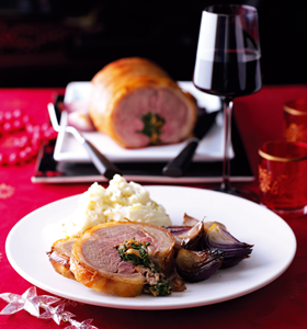 Stuffed Saddle of Lamb with Spinach and Mushrooms
